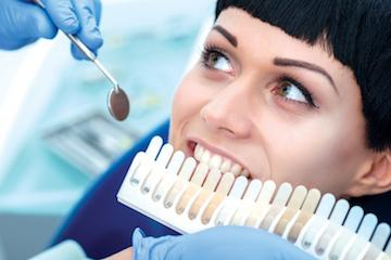 Woman undergoing professional teeth whitening in Huntsville AL