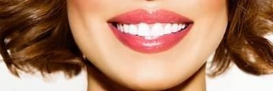 close up of white teeth with red lipstick